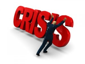 "a man pushing over the word ""crisis"""