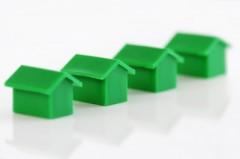 Green plastic monopoly houses, by 123rf.com