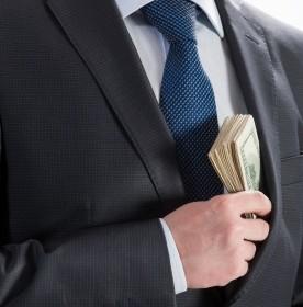 "Businessman pocketing cash - Image Copyright: <a href=""http://www.123rf.com/profile_zestmarina"">zestmarina / 123RF Stock Photo</a>"